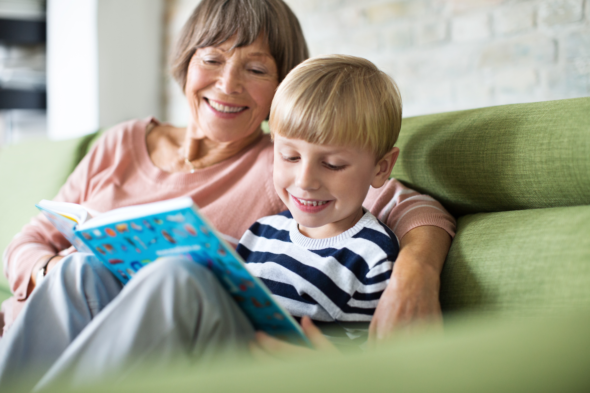 Grandma and Grandson reading a book together